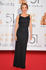 Felicty Huffman showed off her figure in a fitted evening gown with a draped neckline.