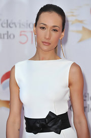 Maggie Q's ultra-long gold dangle earrings complemented her hairstyle perfectly at the Monte Carlo TV Festival.