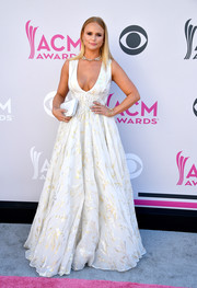 Miranda Lambert chose a white Steven Khalil gown with a plunging neckline and a subtle metallic print for her 2017 ACM Awards look.