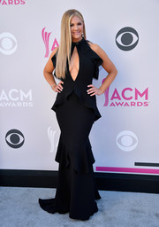 Nancy O'Dell turned up the heat in a black ruffle gown with a cleavage-flaunting keyhole cutout at the 2017 ACM Awards.