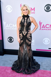 RaeLynn went daring in a sheer, embroidered black gown by Walter Collection at the 2017 ACM Awards.