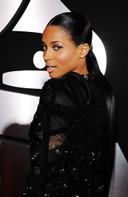 R&B singer Ciara flaunted her sleek ponytail at the Grammy Awards in January 2010. Her stylish hair-style  was a great match to her red carpet look.