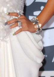 Rihanna shows off this clear bracelet as she poses for the photogs on the red carpet.