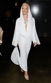 Pink showed off an avant-garde look in a white hooded evening dress.