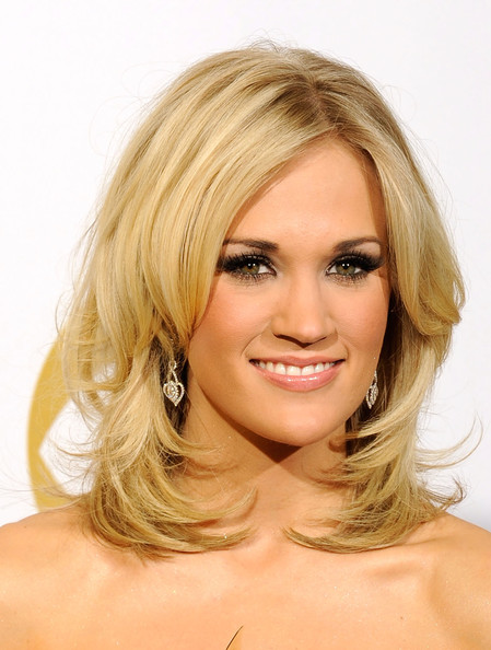 More Pics of Carrie Underwood Medium Curls (1 of 12) - Carrie Underwood Lookbook - StyleBistro [i told you so,hair,face,blond,hairstyle,chin,eyebrow,layered hair,beauty,hair coloring,long hair,carrie underwood,award,country collaboration with vocals,room,press room,staples center,california,los angeles,52nd annual grammy awards]