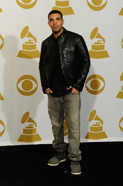Drake dressed up his casual jeans with a sleek leather jacket.