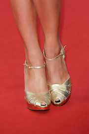Jacqueline MacInnes Wood sparkled on the red carpet in a pair of gold evening pumps during the closing ceremony of the Monte Carlo TV Festival.
