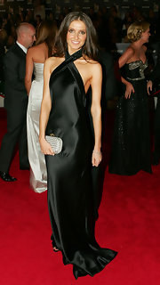 Kate looked amazing in a satin, halter evening gown, carrying the popular Knot Clutch in slate gray satin.