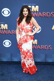 Hillary Scott went for a summery look in a ruffled print gown by Alice + Olivia at the 2018 ACM Awards.