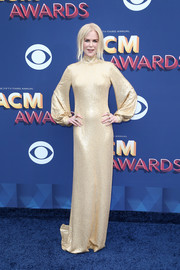 Nicole Kidman looked supremely elegant in a champagne sequin gown by Michael Kors at the 2018 ACM Awards.
