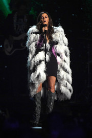 Karen Fairchild coordinated her coat with a pair of dotted boots.