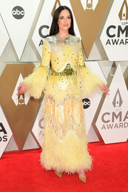 Kacey Musgraves contrasted her ornate dress with simple tan pumps by Christian Louboutin.