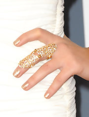 Ariana Grande wore a gold statement ring at the 53rd Annual Grammy Awards.