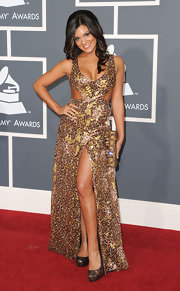 Aleesia wore a dramatic cut-out evening gown with a front slit and leopard print pattern to the Grammy Awards.
