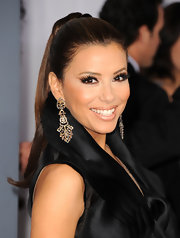 Eva Longoria always looks decadent on the red carpet. The starlet paired her sleek ponytail with elegant diamond earrings.