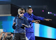The Biebs wore a pair of trendy 'shield' sunglasses while onstage with Usher.