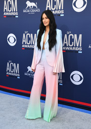 Kacey Musgraves looked super cool in a multi-pastel pantsuit with pleated sleeves and legs at the 2019 ACM Awards.