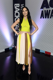 Kacey Musgraves looked vibrant in a neon-yellow cutout crop-top by Cushnie at the ACM Awards Cumulus/Westwood One Radio Remotes.