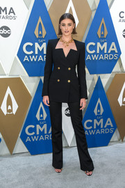 Taylor Hill was sleek and stylish in a black Versace pantsuit with a geometric neckline at the 2020 CMA Awards.