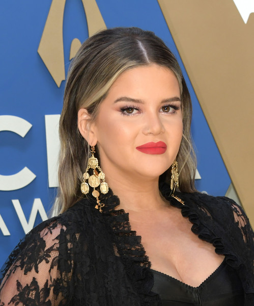 Maren Morris gave her black outfit a pop of color with a swipe of matte red lipstick.