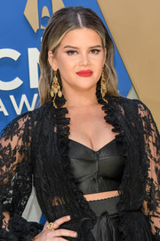 Maren Morris layered a black bra under a sheer lace robe for her 2020 CMA Awards red carpet look.