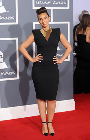 Alicia Keys went the Rihanna route for the occasion, sticking to black and gold in this strong-shouldered ensemble.