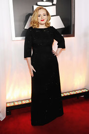 Adele? Is that you? We were blown away by this saucy blond bombshell that strolled onto the Grammy red carpet. Potent red lips and newly lightened pin-up worthy curls gave her black Armani gown a powerful punch.