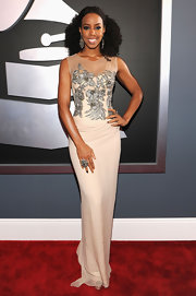 Kelly Rowland is normally one for bold colors or ultra-sexy fashion statements, so it was a bit of a surprise to see her choose this muted Alberta Ferretti number for the Grammys. You can't go wrong with classic elegance.