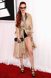 Sky-high strappy sandals gave Porcelain's legs a long lean look at the 54th Grammy Awards in LA.