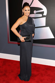 Tia Carrere shimmered in a gray one-shoulder gown at the Grammy Awards.