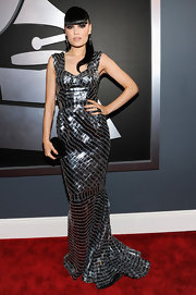 Considering some of Jessie J's prior award show ensembles, her Julien MacDonald mirror gown was actually quite demure. If you can look past the disco ball element, the mermaid silhouette is actually quite pretty.