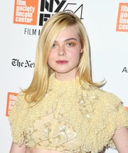 Elle Fanning swiped on some orange eyeshadow for an offbeat beauty look.