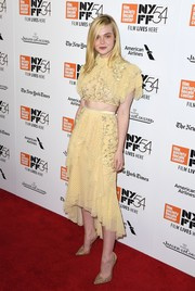 Elle Fanning kept it youthful yet glam in a yellow ruffle crop-top by Rodarte at the New York Film Festival premiere of '20th Century Women.'