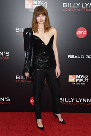 Makenzie Leigh looked bold and sassy in a black one-sleeve sequin top by Saint Laurent at the New York Film Festival screening of 'Billy Lynn's Long Halftime Walk.'