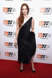Kate Miller opted for an elegant two-tone silk dress when she attended the New York Film Festival photocall for 'Bright Lights.'
