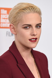 Kristen Stewart paired red lips with smoky eyes for a bold beauty look.