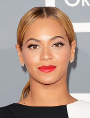 Equal parts ruby and poppy pink, Beyonce's red lips at the 2013 were every part fierce.
