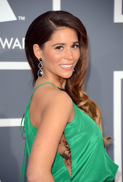 Ali Tamposi's side-swept retro waves showed off her bold dangle earrings at the 2013 Grammys.