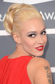 Kaya Jones kept her platinum blonde locks looking sharp with a braided updo at the 2013 Grammys.