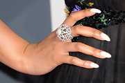 Ashanti's over-sized cocktail ring shimmered in the Grammys' red carpet spotlight.
