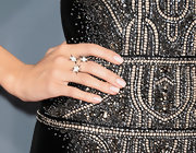 A triple-star ring added some pizazz and sparkle to Allison Williams' minimal jewelry look at the 2013 Grammys.