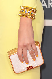 Maria Menounos paired a yellow studded cuff bracelet with her pale yellow dress at the 2013 Grammys.