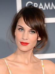 Alexa Chung stayed true to her casual but elegant style with this messy updo pinned back with an adorable hair pin.