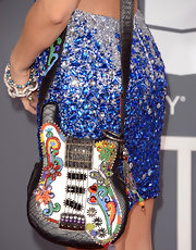 Alicia Arden showed her love of rock and roll with a colorful, leather embellished guitar bag at the 2013 Grammys.