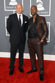 Tyrese Gibson sported a deep brown suit with a little hit of a sheen to it at the 2013 Grammys.