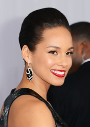Alicia Keys' funky diamond, snake dangle earrings complemented her matching ring and pulled her whole look together.
