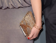 Neyla Pekarek added some edge to her red carpet look with a snakeskin clutch at the 2013 Grammys.
