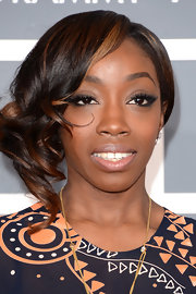 Estelle added some retro flare to her red carpet look with pinned back, retro curls.