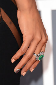 Kelly Rowland's large emerald ring drew attention to her lovely nail art at the 2013 Grammys.