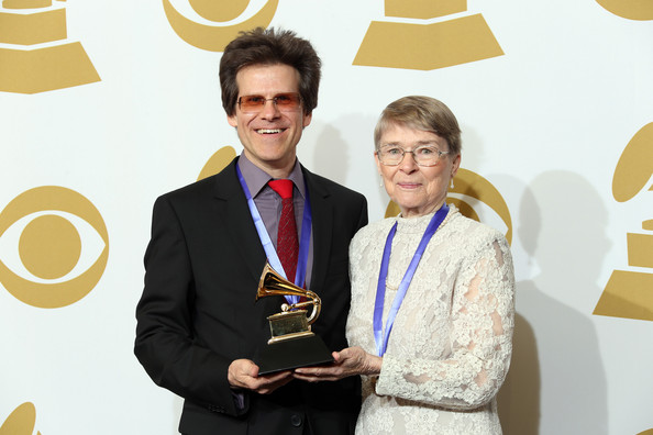 Brent Fischer opted for modern rimless shades at the 2013 Grammy Awards.